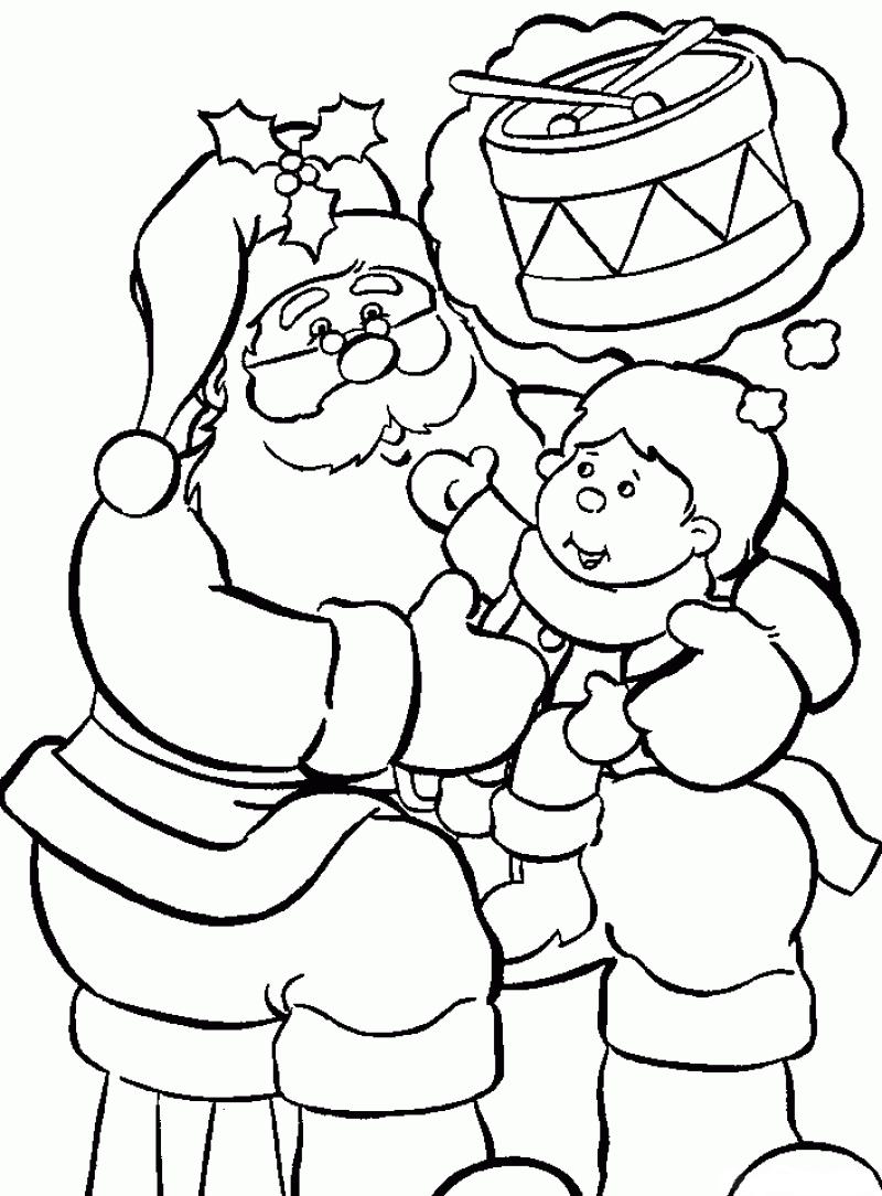 Coloriage enfant dans les bras du père noël à imprimer